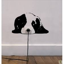виниловая наклейка на розетку: собака, это способ превратить недостаток в достоинство